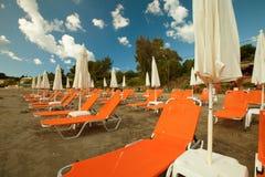 Sunchairs with  umbrellas on beautiful  beach. Travel concept - sunchairs with  umbrellas on beautiful  beach, Zakynthos  island, Greece Stock Photo