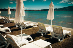 Sunchairs with  umbrellas on beautiful  beach Royalty Free Stock Image