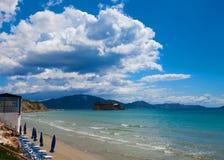 Sunchairs with  umbrellas on beautiful  beach Royalty Free Stock Photo