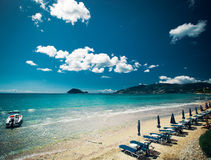 Sunchairs with  umbrellas on beautiful  beach Royalty Free Stock Photos