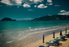 Sunchairs with  umbrellas on beautiful  beach Stock Image