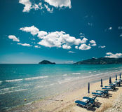 Sunchairs with  umbrellas on beautiful  beach Stock Images