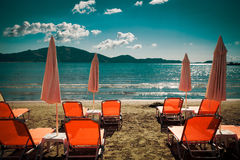 Sunchairs with  umbrellas on beautiful  beach Royalty Free Stock Images