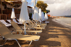 Sunchairs with  umbrellas on beautiful  beach Stock Photography