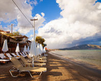 Sunchairs with  umbrellas on beautiful  beach Stock Photos