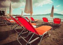Sunchairs with  umbrellas on beautiful  beach. Travel concept - sunchairs with  umbrellas on beautiful  beach, Zakynthos  island, Greece Royalty Free Stock Photos