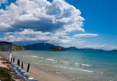 Sunchairs with  umbrellas on beautiful  beach. Travel concept - sunchairs with  umbrellas on beautiful  beach, Zakynthos  island, Greece Royalty Free Stock Photography