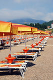Sunchairs and umbrellas on Mediterranean beach Royalty Free Stock Photography