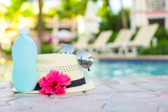 Suncream, hat, sunglasses, flower and tower near Royalty Free Stock Photo