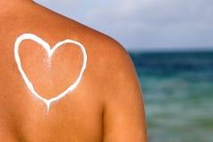 Suncream on the skin Stock Photo
