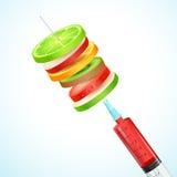Sund frukt i injektionsspruta Arkivfoton