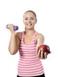 Sund livsstil - äpple för konditionkvinnahänder royaltyfri fotografi