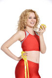 Sund livsstil - äpple för konditionkvinnahand Arkivbild
