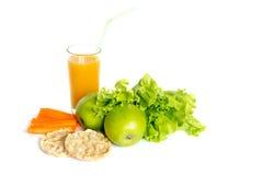 Sund mat på vit bakgrund Arkivfoton
