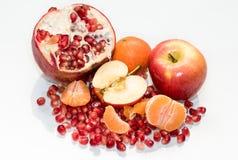 Sund söt äpplegranatrött och mandarin Royaltyfria Foton