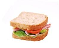 Sund skinksmörgås med ost, tomater Arkivfoto