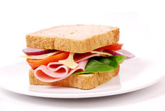 Sund skinksmörgås med ost, tomater Royaltyfri Fotografi