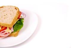 Sund skinksmörgås med ost, tomater Arkivfoton