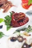 Sund trocknete Tomate mit Petersilie Stockfoto