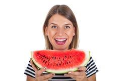 Sund ung kvinna som äter vattenmelon Arkivbilder