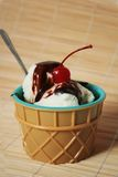 Sundae. Vanilla ice cream sundae with chocolate and cherry stock photo