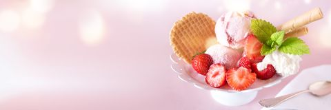 Sundae with strawberries and waffle Royalty Free Stock Photo