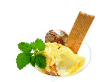 Sundae with waffle. Ice - cream fruit cup with waffle green ticket  on white background Royalty Free Stock Images
