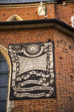 The Sundail on the Mariacki Basilica in Krakow Poland Stock Images