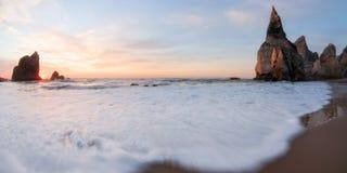 Sundawn at rocky coastline of Atlantic ocean Stock Photo