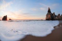 Sundawn at rocky coastline of Atlantic ocean Stock Photos