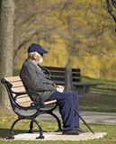 Sunday afternoon. Old man on the bench Stock Images