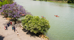 By a Sunday afternoon. Along Guadalquivir River at Sevilla, Spain royalty free stock photos