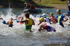 Vlasina Lake, Serbia - august,5.2018:Start of the swimming race on Vlasina triathlon. On Sunday, August 5, the 4th Triathlon Self-Recovery Triathlon was held stock photography