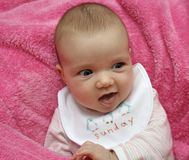 Sunday baby. A baby on a pink blanket royalty free stock photography