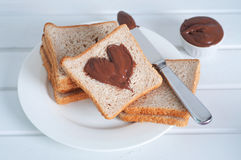 Sunday breakfast. Toast and peanut butter. Royalty Free Stock Image