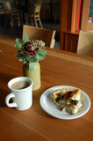Sunday brunch. Coffee, quiche and flower in a vase make a perfect Sundy brunch Royalty Free Stock Photography