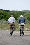 Sunday cycling. Elderly couple cycling on a Sunday afternoon Stock Photos