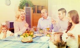 Sunday dinner of family. Sunday dinner in the bosom of cheerful family indoor Stock Photo
