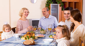 Sunday dinner of family. Cheerful dinner in the bosom of happy family indoor royalty free stock image
