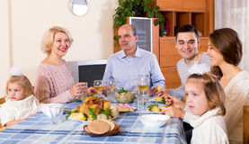 Sunday dinner of family. Cheerful sunday dinner in the bosom of happy family indoor Royalty Free Stock Photography