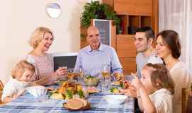 Sunday dinner of family. Cheerful dinner in the bosom of family indoor Royalty Free Stock Photos
