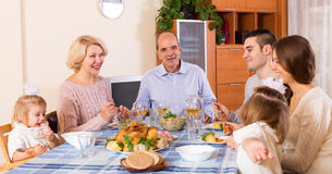 Sunday dinner of family. Holiday dinner in the bosom of beautiful family indoor Royalty Free Stock Images
