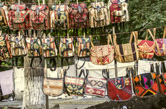 Sunday fair clearance sale of souvenirs backpacks Stock Image