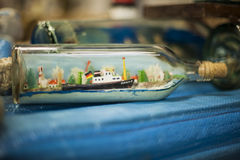 Sunday flea market. Boat in a glass bottle Royalty Free Stock Photography