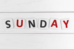Sunday. Inscription on Sunday against a white wood texture Stock Photography
