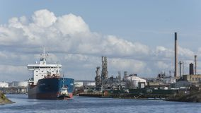 Stanlow oil refinery and the Bro Nyborg oil transport ship as seen from the National waterways museum. Sunday 25 March 2018:  Liverpool Ellesmere Port UK.  The Stock Image