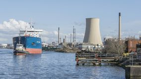 Stanlow oil refinery and the Bro Nyborg oil transport ship as seen from the National waterways museum. Sunday 25 March 2018:  Liverpool Ellesmere Port UK.  The Royalty Free Stock Image