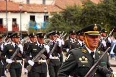 Sunday Marching parade Arequipa. Military and delegations of schools, companies etc. marching past the colonial arcaded buildings surrounding Plaza de Armas at Stock Image