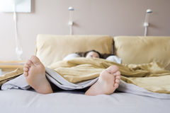 Sunday morning II. Girl lazying in bed on a Sunday morning Stock Photo