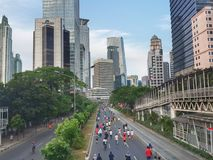 Sunday Morning in Jakarta. Car free day on Sunday morning in Jalan Jenderal Sudirman Jakarta Indonesia. People doing sport activities along the road Stock Images